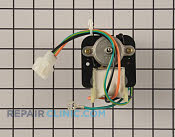 Refrigerator condenser fan motor. The condenser fan motor draws air though the condenser coils and over the compressor