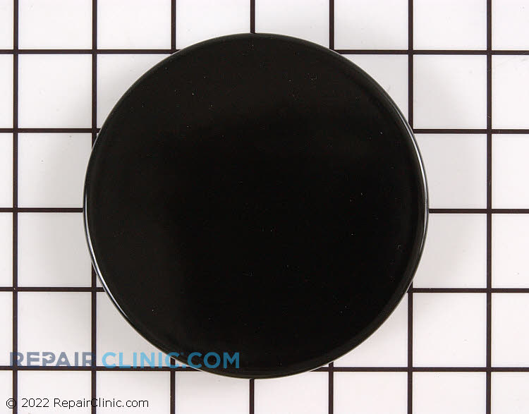Stove top burner head with cap assembly.