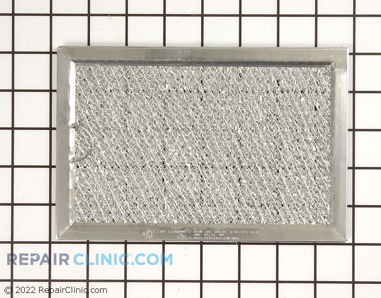 """Grease Filter. Measures approximately 7-3/4"""" X 5"""""""